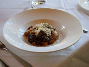 gnocchi con zucca red kuri squash gnocchi with rosemary galric braised short rib ragu, horseradish, pecorino