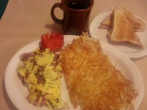 breakfast pastrami scrambled eggs, crispy hashbrowns wheat toast and coffee